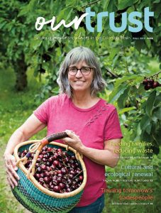 Our Trust Magazine 2019 - Woman outside with basket of fruit